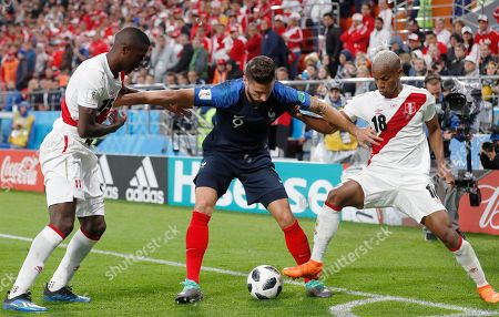 Olivier Giroud of France, Christian Ramos of Peru and Andre Carrillo of Peru