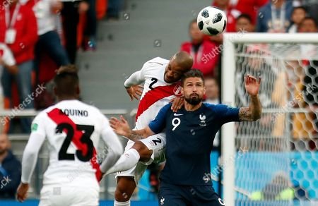 France's Olivier Giroud, right, is airborne with Peru's Alberto Rodriguez during the group C match between France and Peru at the 2018 soccer World Cup in the Yekaterinburg Arena in Yekaterinburg, Russia