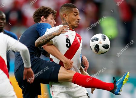 Peru's Alberto Rodriguez, right, is challenged by France's Benjamin Pavard during the group C match between France and Peru at the 2018 soccer World Cup in the Yekaterinburg Arena in Yekaterinburg, Russia