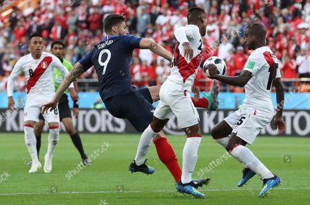 France's Olivier Giroud, left challenges Peru's Pedro Aquino, centre and Peru's Miguel Araujo for the ball during the group C match between France and Peru at the 2018 soccer World Cup in the Yekaterinburg Arena in Yekaterinburg, Russia
