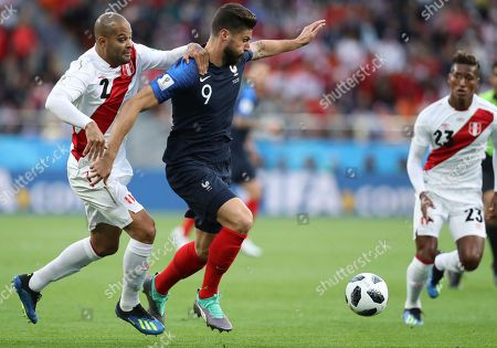 France's Olivier Giroud, right holds off the challenge of Peru's Alberto Rodriguez during the group C match between France and Peru at the 2018 soccer World Cup in the Yekaterinburg Arena in Yekaterinburg, Russia