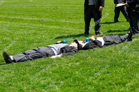 Brian Gleeson and Matt Chapman lie down on the Royal Ascot turf during ITV Racing coverage.