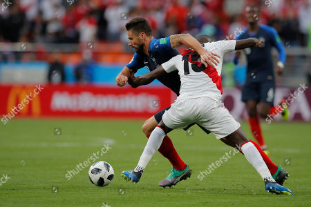France's Olivier Giroud, background, and Peru's Christian Ramos compete for the ball during the group C match between France and Peru at the 2018 soccer World Cup in the Yekaterinburg Arena in Yekaterinburg, Russia