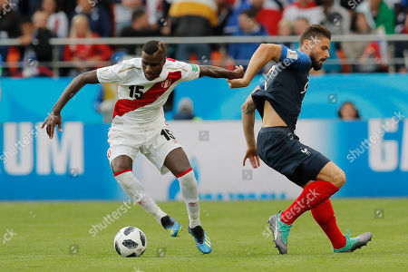 Peru's Christian Ramos, left, and France's Olivier Giroud compete for the ball during the group C match between France and Peru at the 2018 soccer World Cup in the Yekaterinburg Arena in Yekaterinburg, Russia