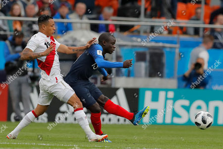 Peru's Christian Ramos, fights for the ball with France's Ngolo Kante during the group C match between France and Peru at the 2018 soccer World Cup in the Yekaterinburg Arena in Yekaterinburg, Russia