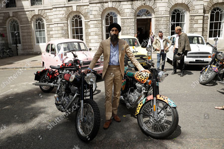 "Indian-born American designer and actor Waris Ahluwalia poses with motorbikes before Britain's Camilla Camilla Duchess of Cornwall arrived to officially launch the start of the Elephant Family Charity's ""Concours d'elephant"", a cavalcade of traditional Indian vehicles that left to tour London to raise awareness of the charity's work to protect the Asian elephant, at the Oriental Club in London"