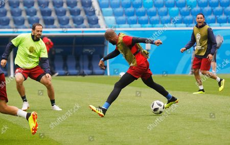 Stock Photo of Costa Rica's Marcos Urena, left, goalkeeper Patrick Pemberton, centre, and goalkeeper Keylor Navas attend Costa Rica's official training on the eve of the group E match between Brazil and Costa Rica at the 2018 soccer World Cup in the St. Petersburg stadium in St. Petersburg, Russia