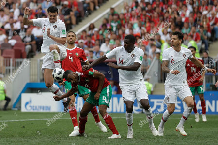 Portugal's Pepe, top, and Morocco's Ayoub El Kaabi challenge for the ball during the group B match between Portugal and Morocco at the 2018 soccer World Cup in the Luzhniki Stadium in Moscow, Russia
