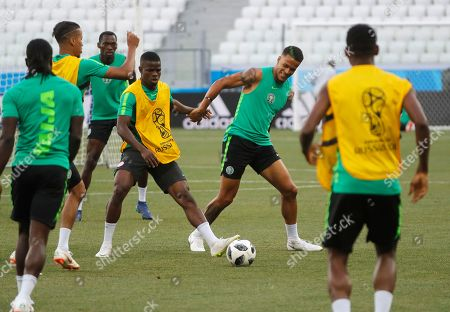 Nigeria players William Troost-Ekong (2nd-R) and Elderson Echiejile (C) in action during Nigeria official training session at the Volgograd Arena in Volgograd, Russia, 21 June 2018. Nigeria will face Iceland  in their first preliminary round Group D match at the FIFA World Cup 2018.