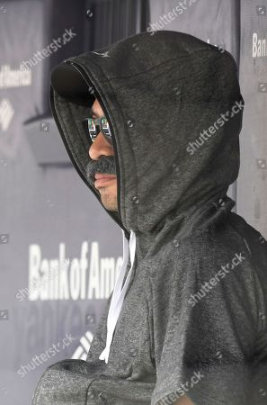 Ichiro Suzuki, special assistant to the chairman of the Seattle Mariners, wears a fake mustache and a hoodie as he sits in the dugout and watches the New York Yankees bat during the first inning of a baseball game, at Yankee Stadium in New York. Suzuki donned a Bobby Valentine-style disguise and sneaked into the Seattle dugout to watch a bit of the action