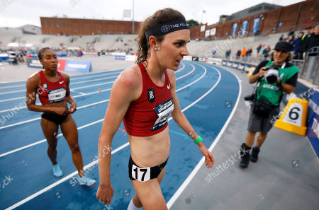 Gwen Jorgensen walks off the track after finishing the women's 10,000 meters at the U.S. Championships athletics meet, in Des Moines, Iowa