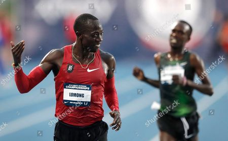 Lopez Lomong smiles as he wins the men's 10,000 meters at the U.S. Championships athletics meet, in Des Moines, Iowa