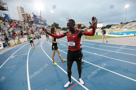 Lopez Lomong celebrates after winning the men's 10,000 meters at the U.S. Championships athletics meet, in Des Moines, Iowa