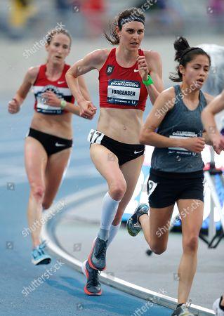 Gwen Jorgensen, center, runs during the women's 10,000-meter run at the U.S. Championships athletics meet, in Des Moines, Iowa
