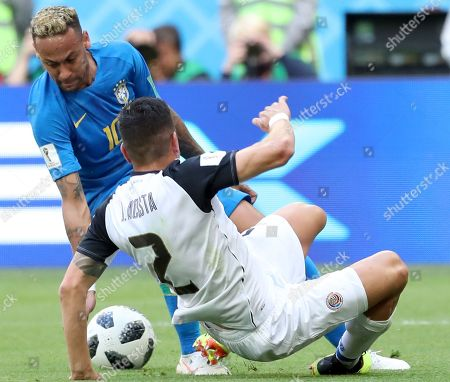 Neymar (L) of Brazil and Johnny Acosta of Costa Rica in action during the FIFA World Cup 2018 group E preliminary round soccer match between Brazil and Costa Rica in St.Petersburg, Russia, 22 June 2018.
