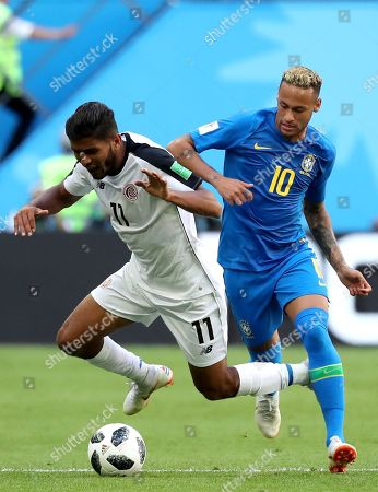 Johan Venegas (L) of Costa Rica and Neymar of Brazil in action during the FIFA World Cup 2018 group E preliminary round soccer match between Brazil and Costa Rica in St.Petersburg, Russia, 22 June 2018.