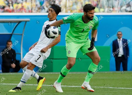Christian Bolanos of Costa Rica and Goalkeeper Alisson of Brazil