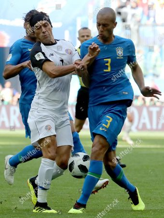 Christian Bolanos (L) of Costa Rica and Miranda of Brazil in action during the FIFA World Cup 2018 group E preliminary round soccer match between Brazil and Costa Rica in St.Petersburg, Russia, 22 June 2018. (RESTRICTIONS APPLY: Editorial Use Only, not used in association with any commercial entity - Images must not be used in any form of alert service or push service of any kind including via mobile alert services, downloads to mobile devices or MMS messaging - Images must appear as still images and must not emulate match action video footage - No alteration is made to, and no text or image is superimposed over, any published image which: (a) intentionally obscures or removes a sponsor identification image; or (b) adds or overlays the commercial identification of any third party which is not officially associated with the FIFA World Cup)