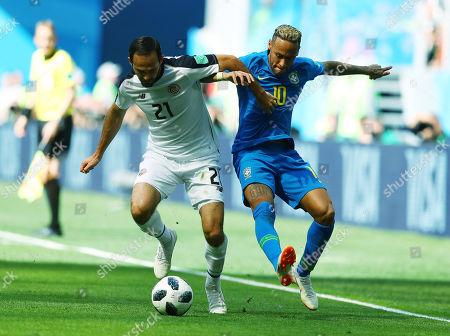 Neymar of Brazil and Marco Urena of Costa Rica