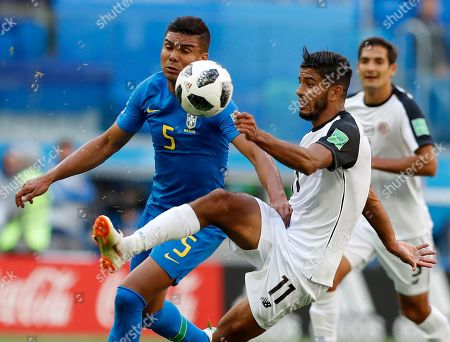 Costa Rica's Johan Venegas, right, kicks the ball away from Brazil's Casemiro during the group E match between Brazil and Costa Rica at the 2018 soccer World Cup in the St. Petersburg Stadium in St. Petersburg, Russia