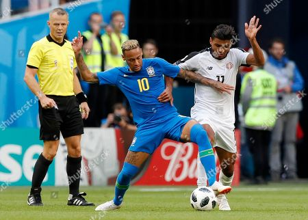 Brazil's Neymar, left, and Costa Rica's Johan Venegas battle for the ball during the group E match between Brazil and Costa Rica at the 2018 soccer World Cup in the St. Petersburg Stadium in St. Petersburg, Russia