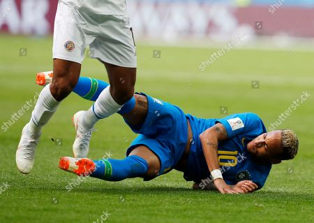 Brazil's Neymar falls as he tangles in the legs of Costa Rica's Johan Venegas during the group E match between Brazil and Costa Rica at the 2018 soccer World Cup in the St. Petersburg Stadium in St. Petersburg, Russia