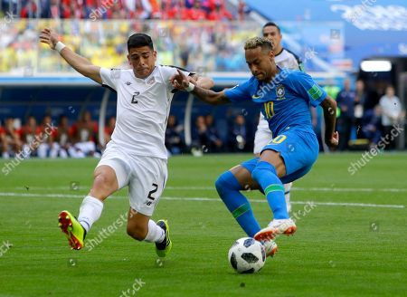Brazil's Neymar, right, looks to kick the ball past Costa Rica's Johnny Acosta during the group E match between Brazil and Costa Rica at the 2018 soccer World Cup in the St. Petersburg Stadium in St. Petersburg, Russia