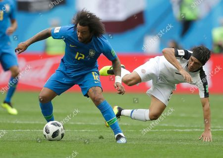 Brazil's Marcelo, left, challenges for the ball with Costa Rica's Christian Bolanos during the group E match between Brazil and Costa Rica at the 2018 soccer World Cup in the St. Petersburg Stadium in St. Petersburg, Russia