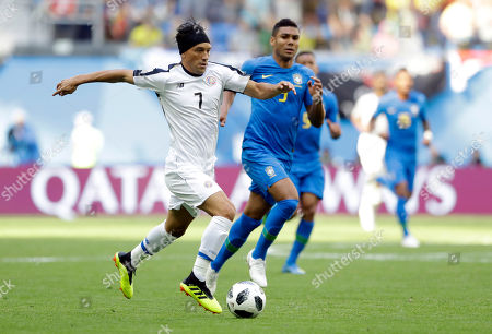 Costa Rica's Christian Bolanos runs with the ball during the group E match between Brazil and Costa Rica at the 2018 soccer World Cup in the St. Petersburg Stadium in St. Petersburg, Russia