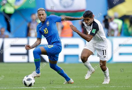 Brazil's Neymar and Costa Rica's Johan Venegas, right, battle for the ball during the group E match between Brazil and Costa Rica at the 2018 soccer World Cup in the St. Petersburg Stadium in St. Petersburg, Russia