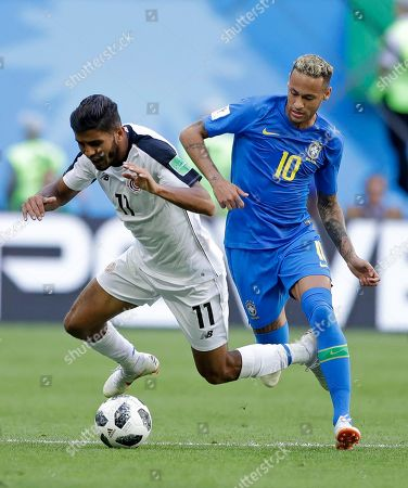 Costa Rica's Johan Venegas is fouled by Brazil's Neymar during the group E match between Brazil and Costa Rica at the 2018 soccer World Cup in the St. Petersburg Stadium in St. Petersburg, Russia