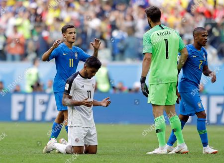 Brazil's Philippe Coutinho, left, Costa Rica's Johan Venegas react at the end of the group E match between Brazil and Costa Rica at the 2018 soccer World Cup in the St. Petersburg Stadium in St. Petersburg, Russia, . Brazil won the match 2-0
