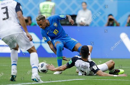 Brazil's Neymar is challenged by Costa Rica's Johnny Acosta during the group E match between Brazil and Costa Rica at the 2018 soccer World Cup in the St. Petersburg Stadium in St. Petersburg, Russia