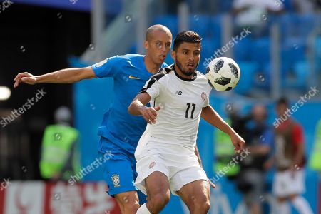 Costa Rica's Johan Venegas, right, and Brazil's Miranda challenge for the ball during the group E match between Brazil and Costa Rica at the 2018 soccer World Cup in the St. Petersburg Stadium in St. Petersburg, Russia
