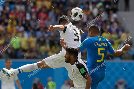 Brazil's Casemiro, right, challenge for the ball with Costa Rica's Giancarlo Gonzalez, left, and Costa Rica's Johan Venegas, during the group E match between Brazil and Costa Rica at the 2018 soccer World Cup in the St. Petersburg Stadium in St. Petersburg, Russia