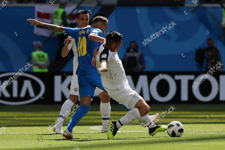 Brazil's Neymar, left, and Costa Rica's Johnny Acosta challenge for the ball during the group E match between Brazil and Costa Rica at the 2018 soccer World Cup in the St. Petersburg Stadium in St. Petersburg, Russia