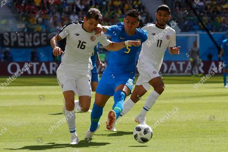 Costa Rica's Cristian Gamboa, left, and Brazil's Casemiro challenge for the ball during the group E match between Brazil and Costa Rica at the 2018 soccer World Cup in the St. Petersburg Stadium in St. Petersburg, Russia