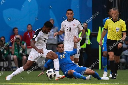 Costa Rica's Johan Venegas, left, and Brazil's Fagner, center, challenge for the ball during the group E match between Brazil and Costa Rica at the 2018 soccer World Cup in the St. Petersburg Stadium in St. Petersburg, Russia