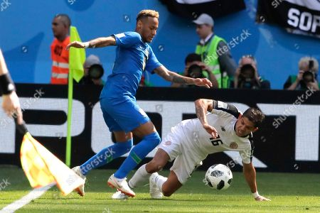 Brazil's Neymar, left, and Costa Rica's Cristian Gamboa challenge for the ball during the group E match between Brazil and Costa Rica at the 2018 soccer World Cup in the St. Petersburg Stadium in St. Petersburg, Russia
