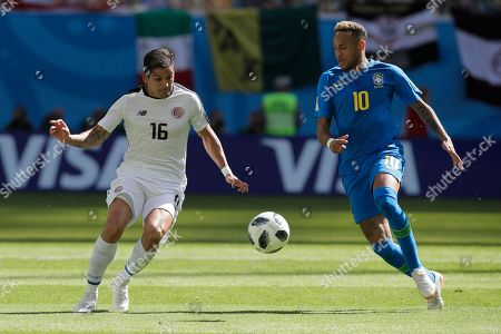 Brazil's Neymar, right, and Costa Rica's Cristian Gamboa challenge for the ball during the group E match between Brazil and Costa Rica at the 2018 soccer World Cup in the St. Petersburg Stadium in St. Petersburg, Russia