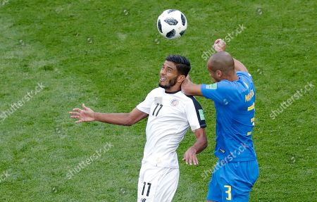 Costa Rica's Johan Venegas, left, challenges for the ball with Brazil's Miranda during the group E match between Brazil and Costa Rica at the 2018 soccer World Cup in the St. Petersburg Stadium in St. Petersburg, Russia