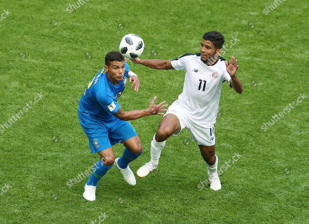 Thiago Silva of Brazil and Johan Venegas of Costa Rica