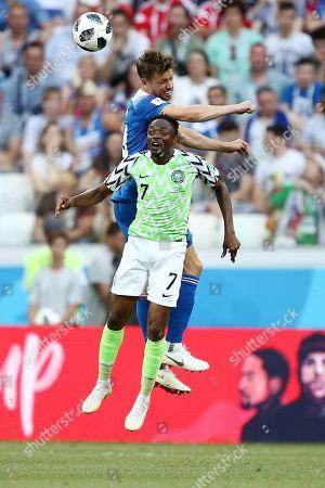 Kari Arnason of Iceland and Ahmed Musa of Nigeria