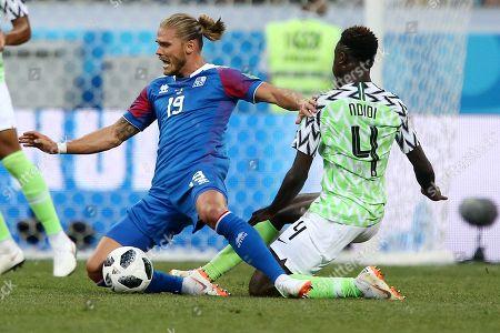 Rurik Gislason of Iceland is fouled by Wilfred Ndidi of Nigeria