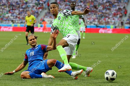 Tyronne Ebuehi of Nigeria is tackled by Rurik Gislason of Iceland