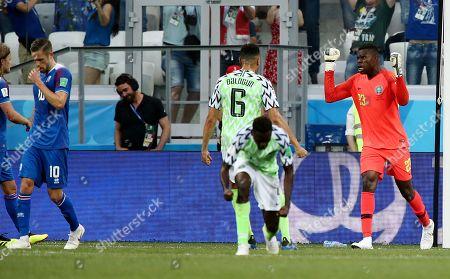 Goalkeeper Francis Uzoho of Nigeria celebrates after a penalty miss from Gylfi Sigurdsson of Iceland