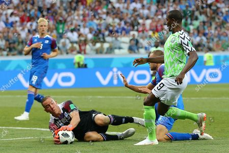 Odion Ighalo of Nigeria has his shot saved by Goalkeeper Hannes Halldorsson of Iceland