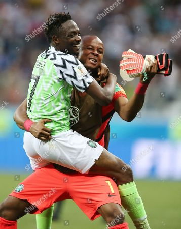 Stock Image of Ahmed Musa of Nigeria celebrates with Goalkeeper Ikechukwu Ezenwa at the end of the match