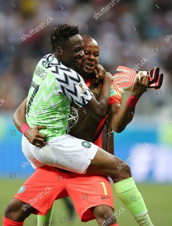 Stock Photo of Ahmed Musa of Nigeria celebrates with Goalkeeper Ikechukwu Ezenwa at the end of the match