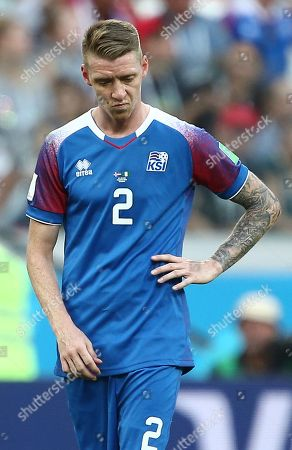 Stock Photo of Birkir Mar Saevarsson of Iceland looks dejected